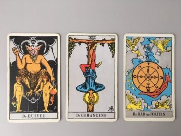 De Duivel, De Gehangene en het Rad van Fortuin uit het Waite Tarot Deck